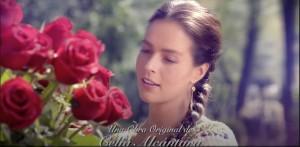 Univisión Telenovelas Lovely girl looking at red rose bush