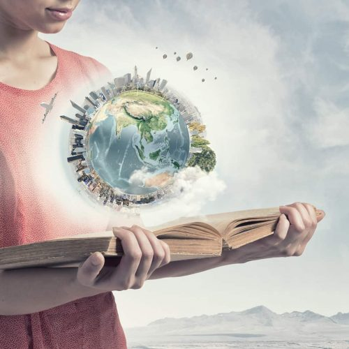 World Language Blogs Picture of a woman holding a book with an atlas above the book